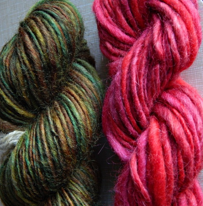 The red yarn on the right is around my 3rd spinning attempt, while the green on the left is my 8th.