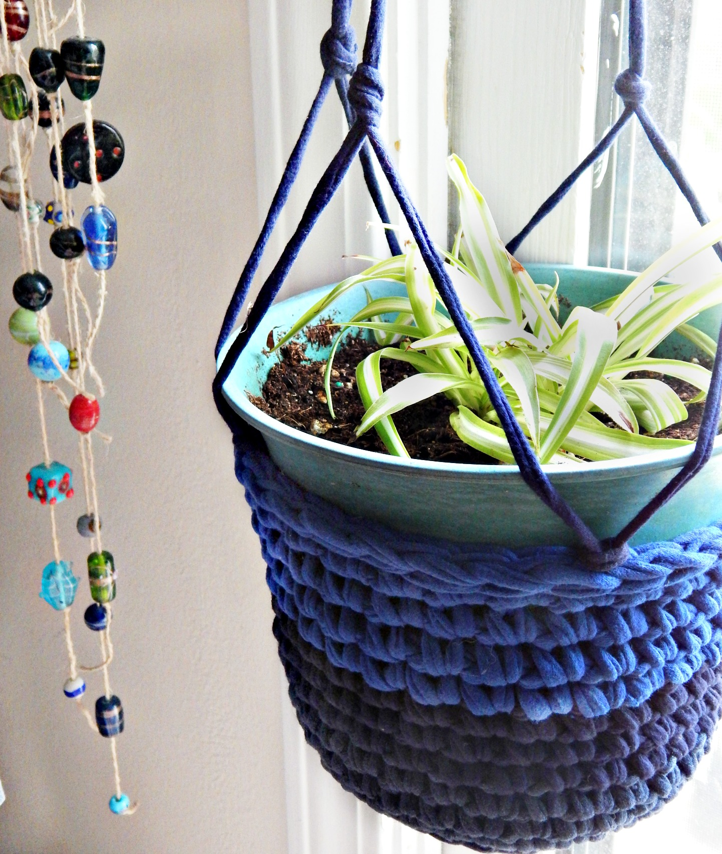 Make sure the plant is secure. This hanging plant holder is super easy to make and can be made from a variety of different materials yarn, rope, hemp, ect. You can also make these holders larger or smaller depending on the size of plant you are hanging.